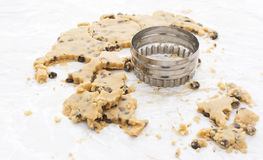 Cookie cutter with chocolate chip dough Stock Images