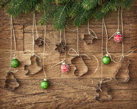 Cookie cutter and christmas baubles Royalty Free Stock Photo
