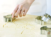 Cookie cutter and dough Stock Image