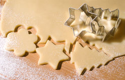 Cookie-cutter forms. Dough and christmas cookie cutter forms stock photo