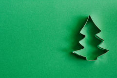 Cookie cutter on green Stock Photography
