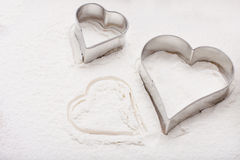 Cookie cutter in heart shape Royalty Free Stock Photography