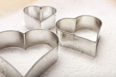 Cookie cutter in heart shape Stock Photos