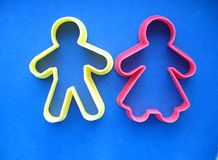 Cookie cutter people. Cookie cutters in the shape of a man and woman Royalty Free Stock Image