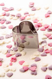 Cookie cutter and sugar hearts Royalty Free Stock Images