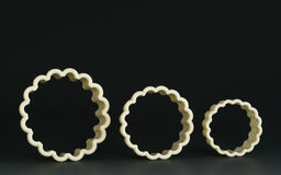 Cookie Cutters. Three old plastic cookie and biscuit cutters on thunder grey gradient background royalty free stock image