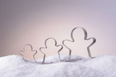 Cookie cutters for Christmas cookies in the snow Royalty Free Stock Photography