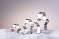 Cookie cutters for Christmas cookies in the snow Royalty Free Stock Image