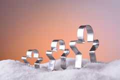 Cookie cutters for Christmas cookies in the snow Stock Photo
