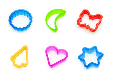 Cookie cutters collage. Colored cookie cutters collage isolated Royalty Free Stock Photo