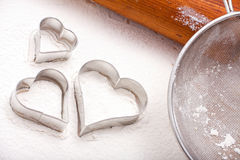 Cookie cutters and flour sieve Royalty Free Stock Photo