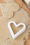 Cookie cutters in the form of heart in cookie dough Royalty Free Stock Photo
