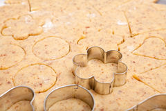Cookie cutters on fresh cookie dough Royalty Free Stock Image