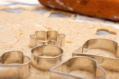 Cookie cutters on fresh dough Stock Image