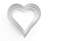 Cookie cutters. Hearts Cookie cutters on white background Royalty Free Stock Image