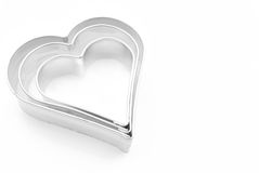 Cookie cutters. Hearts Cookie cutters on white background Stock Photography