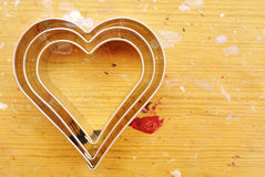 Cookie cutters. Hearts Cookie cutters on wood background Royalty Free Stock Image