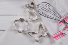 Cookie cutters  and kitchen tools on parchment paper Royalty Free Stock Images