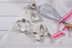 Cookie cutters  and kitchen tools on parchment paper Royalty Free Stock Image