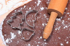 Cookie cutters and rolling pin on dough for cookies and gingerbread Stock Photos