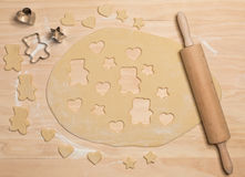 Cookie cutters, rolling pin and dough Royalty Free Stock Image