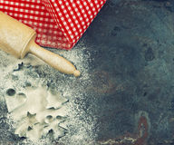 Cookie cutters, rolling pin and flour. Christmas food. Festive b Royalty Free Stock Image