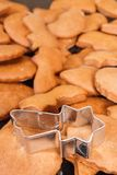 Cookie cutters in shape of star and fresh baked gingerbread or cookies for Christmas. Cookie cutters in shape of star and fresh baked homemade gingerbread or Stock Photos