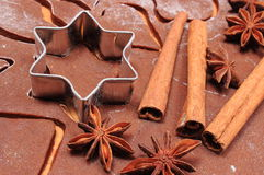 Cookie cutters and spice on dough for gingerbread Royalty Free Stock Image