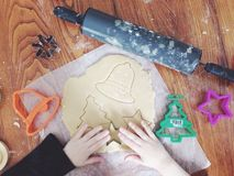 Cookie cutting. Child making sugar cookies Royalty Free Stock Photography