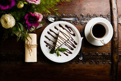 Cookie on a decorated plate. Cake on a decorated plate on an old countertop with flower arrangement stock images