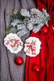Cookie with deers and numbers 2019 on the background with fir branches and red balls, top view. Holiday sweets. New Year`s and Ch stock image