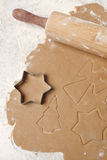 Cookie dough. With christmas angles, trees and stars Stock Photography