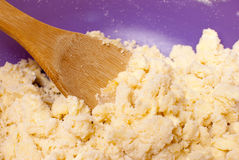Cookie Dough. Coarsely mixed cookie dough with a wooden spoon Royalty Free Stock Photography