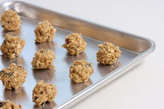 Cookie Dough. Partial view of baking sheet with oatmeal cookie dough ready for baking Royalty Free Stock Photo