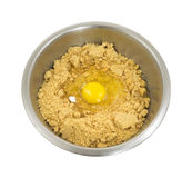 Cookie dough in bowl with broken egg shell Stock Photography