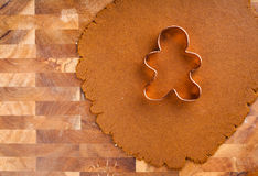 Cookie Dough. Christmas cookie dough rolled out with gingerbread man cookie cutter. Copy space for your type stock photography