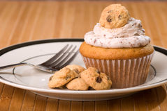 Cookie Dough Cupcake with Sprinkled Icing Stock Images