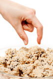 Cookie Dough Eat. A hand reaching for a bowl of raw cookie dough Stock Images