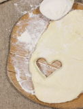 Cookie dough in the form of heart. symbol of love Stock Image