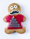 Cookie engraçada do pão-de-espécie em um fundo branco Imagens de Stock