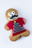 Cookie engraçada do pão-de-espécie em um fundo branco Fotos de Stock
