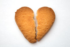 Cookie in the form of broken hearts - symbol of love. Tasty cookies in the form of broken hearts - a symbol of love royalty free stock image