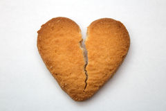 Cookie in the form of broken hearts - symbol of love. Tasty cookies in the form of broken hearts - a symbol of love royalty free stock photo