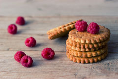 Cookie and fresh raspberry. On wooden background Stock Images