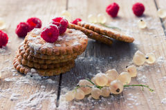 Cookie and fresh raspberry. On wooden background Stock Image