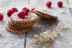 Cookie and fresh raspberry. On wooden background Royalty Free Stock Images