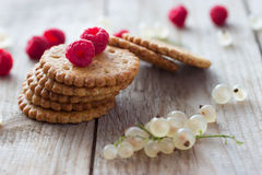 Cookie and fresh raspberry. On wooden background Royalty Free Stock Photo