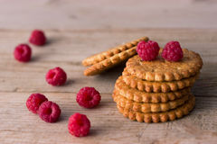 Cookie and fresh raspberry. On wooden background Stock Photos