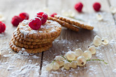 Cookie and fresh raspberry. On wooden background Royalty Free Stock Photography