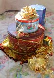 Cookie gift. The cookie tins are ready and need their ribbon wraps stock photos